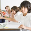 Schoolchildren and their teacher in an art class — Stock Photo #4759589