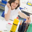 A schoolgirl in an art class — Stock Photo