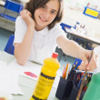 Stock Photo: A schoolgirl in an art class