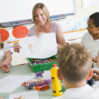 Schoolchildren and their teacher in an art class — Stock Photo #4759591