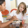 Stock Photo: Schoolgirls in science class