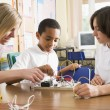 Schoolchildren and their teacher in a science class - Stock Photo