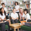 Stock Photo: Junior school students working in a library