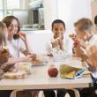 Schoolchildren enjoying their lunch in a school cafeteria — Stock Photo