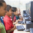 Kindergarten children learning how to use computers. — Stock Photo
