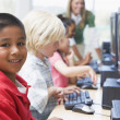 Stock Photo: Kindergarten children learning how to use computers.
