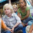 Kindergarten children listening to a story — Stock Photo