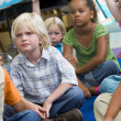 Stock Photo: Kindergarten children listening to story