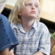 Boy daydreaming at kindergarten — Stock Photo