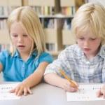 Kindergarten children learning to write — Stock Photo