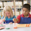 Kindergarten children painting — Stock Photo #4759789