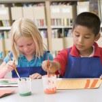 Kindergarten children painting — Stock Photo #4759789