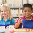 Kindergarten children painting - Stock Photo