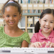 Kindergarten children using computer — Stock Photo