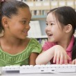 Kindergarten children using computer — Stock Photo #4759797