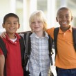 Three kindergarten boys standing together — Stock Photo