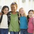 Three kindergarten girls standing together - Stock Photo