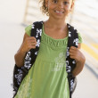 Portrait of kindergarten girl with backpack - Stock Photo