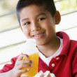 Stock Photo: Boy eating lunch at kindergarten