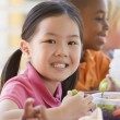 Kindergarten children eating lunch — Stock Photo