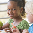 Kindergarten children eating lunch — Stock Photo #4759861