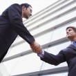 Royalty-Free Stock Photo: Businessmen shaking hands outside office building