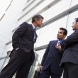 Royalty-Free Stock Photo: Group of businessmen talking outside office building