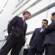 Royalty-Free Stock Photo: Group of businessmen talking outside office