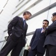 Group of businessmen talking outside office — Stock Photo #4759934