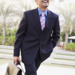 Businessman walking to office — Stock Photo #4759989