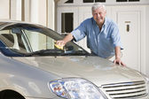 Senior man cleaning car — Stock Photo
