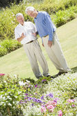 Senior men standing in garden — Stock Photo