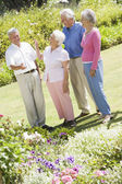 Group of senior friends in garden — Stock Photo