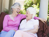 Senior female friends laughing together — Stock Photo