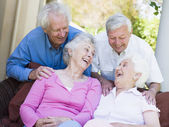 Group of senior friends laughing — Stockfoto