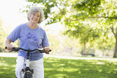 Senior woman on cycle ride — Stock Photo