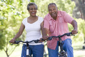 Senior couple on cycle ride — Stock Photo