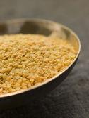 Dish of Split Yellow Mustard Seeds — Stock Photo