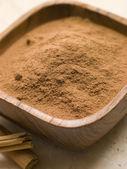 Ground Cinnamon Powder with Cinnamon Bark — Stock Photo