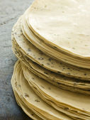 Stack of uncooked Papadoms — Stock Photo