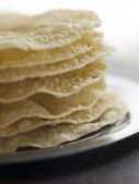 Stack of cooked Papadoms — Stock Photo