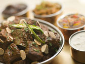 Meat Madras Restaurant Style with Raita and Chutneys — Stock Photo