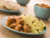 Plated Chicken Korma with Pilau Rice and Naan bread — Stock Photo