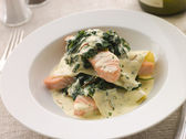 Open Lasagne of Salmon and Spinach with a Saffron Cream — Stock Photo