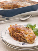 Portion of Lasagne with Basil — Stock Photo