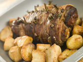 Roast Leg of Lamb Studded with Garlic and Rosemary and Roast Pot — Stock Photo