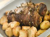 Roast Leg of Lamb Studded with Garlic and Rosemary and Roast Pot — Stock Photo