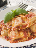 Veal and Sage Ravioli with Tomato and Basil Sauce — Stock Photo