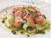 Citrus marinated Salmon with Cucumber Salad — Stock Photo
