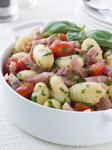 Bowl of Gnocchi with a Bacon Tomato and Basil Dressing — Stock Photo